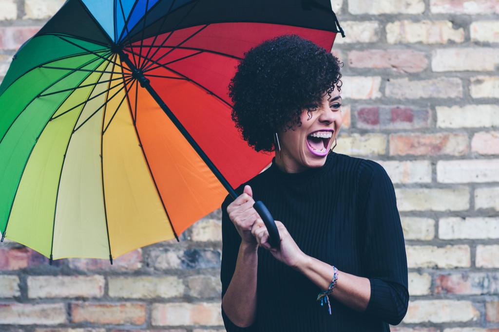 Brunette with rainbow umbrella